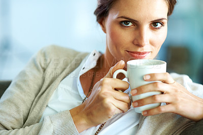 Buy stock photo Pretty young female having a cup of coffee