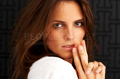 Buy stock photo Beautiful young woman looking confidently