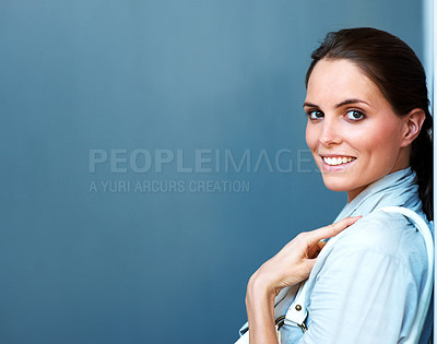 Buy stock photo Sweet young woman smiling against grey background