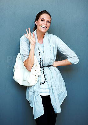 Buy stock photo An excited young woman greeting you hello