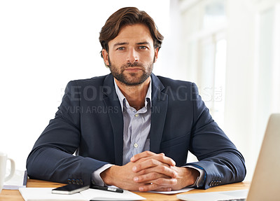 Buy stock photo A handsome businessman focused at his desk