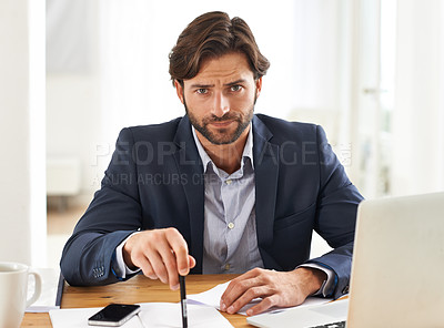 Buy stock photo A handsome businessman  appearing tense at his desk