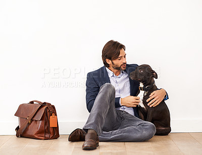 Buy stock photo An attractive businessman sitting alongside his loyal dog