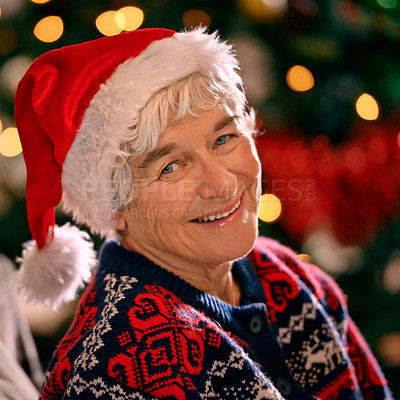 Buy stock photo A senior woman sitting indoors wearing a Christmas hat