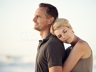 Buy stock photo A happy couple embracing on the beach