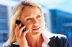 Closeup of a young business woman speaking on cell phone