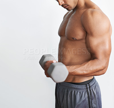 Buy stock photo A muscular man lifting dumbbells