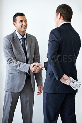 Buy stock photo Cropped shot of a businessman taking a bribe