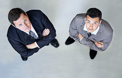 Buy stock photo High-angle portrait two businessmen standing with their arms folded