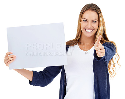 Buy stock photo Studio shot of a young woman carrying a blank placard and giving a thumbs up