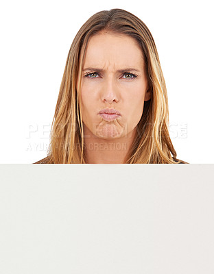 Buy stock photo Studio portrait of frowning woman holding up a blank sign isolated on white