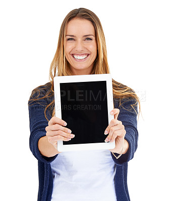 Buy stock photo Studio shot of a young woman holding a digital tablet