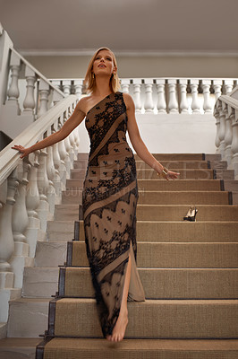 Buy stock photo Full-length shot of a beautiful young woman standing on a staircase in a formal interior