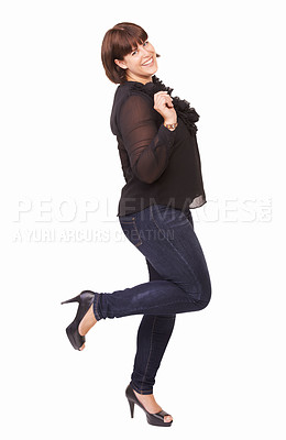 Buy stock photo Portrait of a playful young brunette woman lifting on foot on a white background