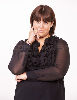 Buy stock photo Portrait of a pretty young brunette with a thoughtful look on her face