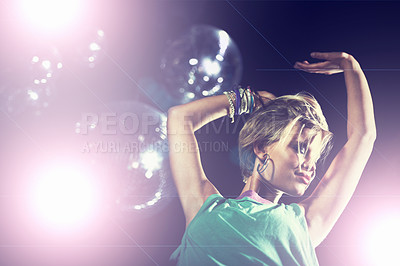 Buy stock photo Shot of an attractive and stylish young woman in a night club