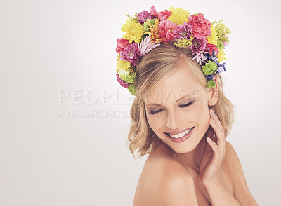Buy stock photo A young woman posing with her eyes shut and flowers in her hair
