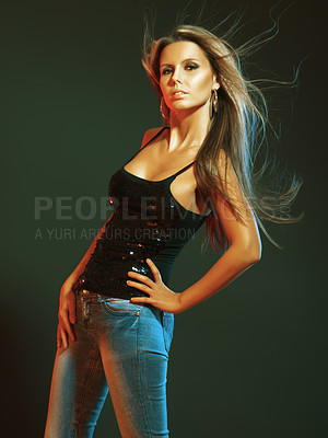 Buy stock photo Portrait of a beautiful woman posing in a sequined top and fitting denim jeans