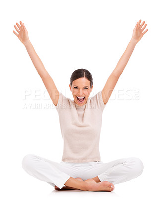Buy stock photo A young woman sitting with her arms raised in victory