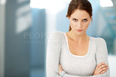 Buy stock photo Cute young woman staring at you in anger