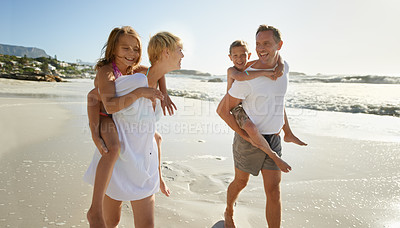 Buy stock photo Smiling parents carrying their son and daughter down the beach