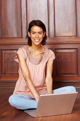 Buy stock photo Pretty young woman sitting with laptop