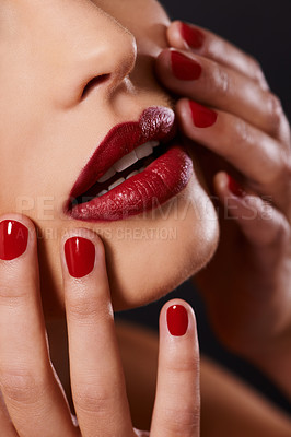 Buy stock photo Cropped image of a woman touching her face wearing red lipstick and nail polish