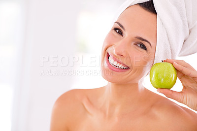 Buy stock photo Closeup portrait of a beautiful woman holding an apple next to her face