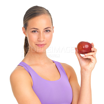 Buy stock photo Studio portrait of a sporty young woman holding a red apple against a white background