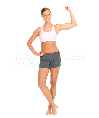 Buy stock photo Full length studio portrait of a young woman flexing her bicep against a white background