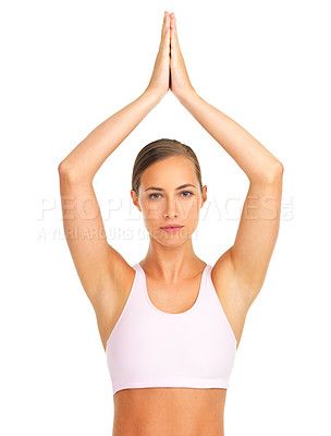 Buy stock photo Studio portrait of a young woman in a yoga pose isolated on white