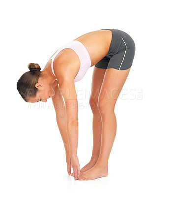 Buy stock photo Full length shot of a young woman limbering up against a white background