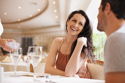 Buy stock photo A married couple sitting at a table in a restaurant