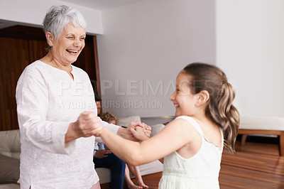 Buy stock photo A grandmother and granddaughter dancing