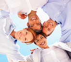 Upward view of business colleagues with heads together