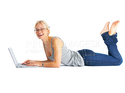 Buy stock photo Studio portrait of a young woman lying on the floor using a laptop isolated on white