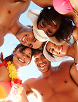 Upward view of group of friends at the beach