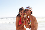 Beautiful teenage girls in bikini holding a conch shell
