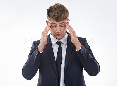 Buy stock photo Shot of a stressed out business man against a white background