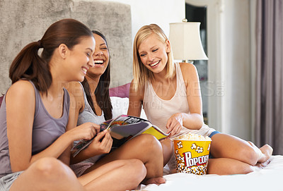 Buy stock photo Portrait of a group of female friends spending quality time together at home