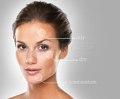 Buy stock photo Conceptual studio portrait of a young woman labeled with skin types