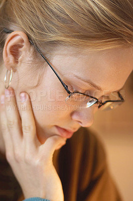 Buy stock photo Young female with glasses studying