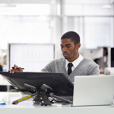 Buy stock photo Cropped shot of a young man working on a large touchscreen