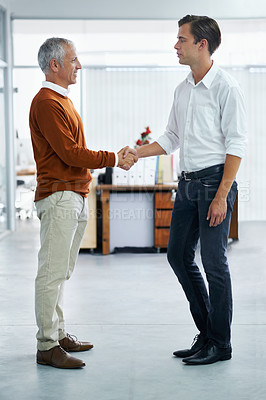 Buy stock photo Two businessmen sharing a handshake