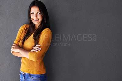 Buy stock photo Shot of a beautiful young woman against a gray background