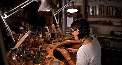 Buy stock photo An artist creating something out of wood