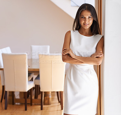 Buy stock photo Portrait of an attractive young woman in a dress standing in a doorway