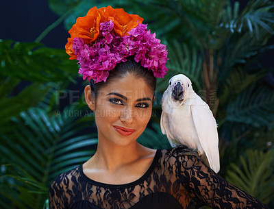Buy stock photo Portrait of an exotic looking woman with a parrot perched on her hand