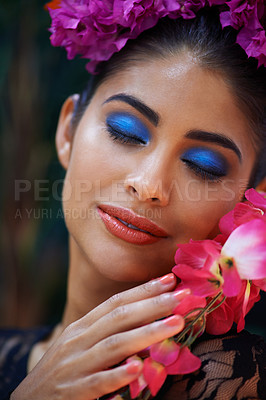 Buy stock photo A beautiful woman with her eyes closed wearing colourful flowers