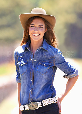 Buy stock photo Cropped image of a young cowgirl outside in the sun